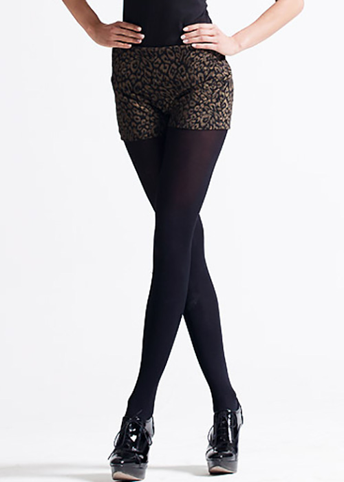 Animal print shorts with black opaque tights